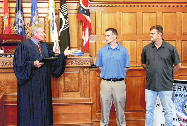 Anna Bolton | Greene County News Judge Stephen A. Wolaver addresses graduates Samuel Noble, U.S. Army Infantry, and Eddie Parks, U.S. Marine Corps, at the second Greene County Veterans' Treatment Court graduation Aug. 23.