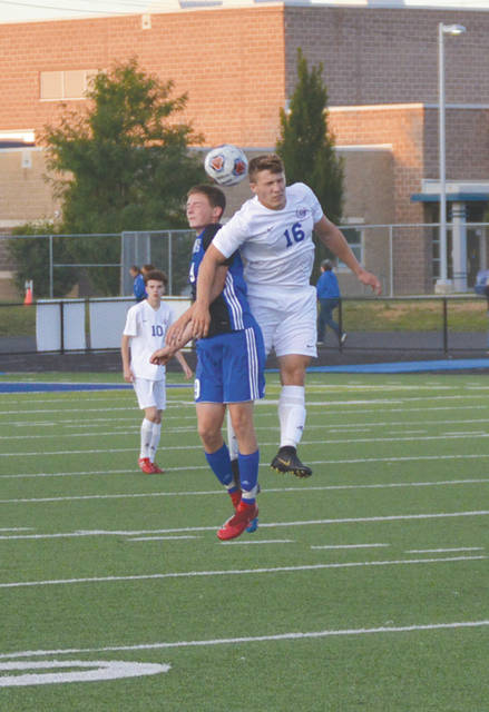 Xenia junior defender Madix O'Bryant and Greeneview junior midfielder Jayden DeHaven both grimace as they collide while going up to head the ball, during the first half of Friday's boys high school soccer match at Doug Adams Stadium. Xenia won on a late goal, 1-0.