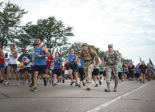 Submitted photo U.S. Air Force Col. Thomas P. Sherman, 88th Air Base Wing commander, and Chief Master Sgt. Stephen Arbona, 88th ABW command chief, along with other runners take off at the start of the Run for the Fallen event at Wright-Patterson Air Force Base, Ohio, Sept. 11, 2019. The event was held to mark the 18th anniversary of the 9/11 terrorist attacks.