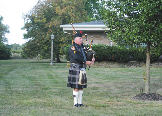 Retired Sergeant Del Braund, of the Montgomery County Sheriff's Office, concluded the event with the playing of bagpipes.