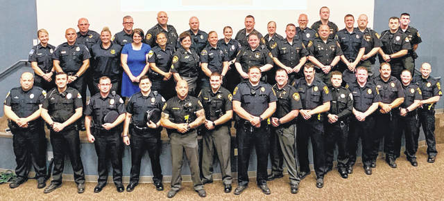 Photos courtesy MHRB Law enforcement officials from Clark, Greene and Madison counties graduate from Crisis Intervention Team training Sept. 13.