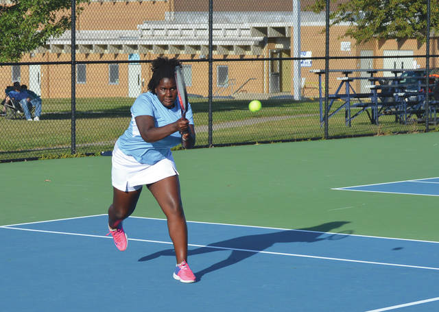 Fairborn first singles player Eva Gibson clubs a two-handed shot during her win Wednesday, Sept. 18 at Fairborn Community Park.