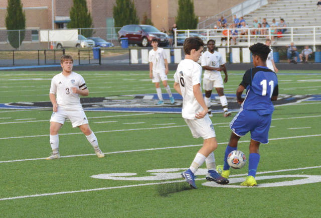 Donovan Dierker (6) of Fairborn battles with Xenia defender A.J. Ruffin for a pass from brother and teammate Keegan Dierker (3) in the first half of Thursday's boys high school soccer match at Doug Adams Stadium in Xenia.