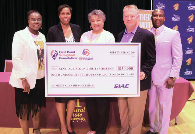 Officials (Left to Right) Sharon Clark, President-Elect of the American Volleyball Coaches Association; Tara A. Owens, Central State University's Director of Athletics; Dr. Cynthia Jackson-Hammond, CSU President; Wade Garard, CEO of First Point Volleyball; and Anthony Holloman, the Southern Intercollegiate Athletic Conference Men's Volleyball Chairman, pose with a check for $150,000 presented to the school on Sept. 3, as CSU announced it will create a men's NCAA Division II volleyball program.