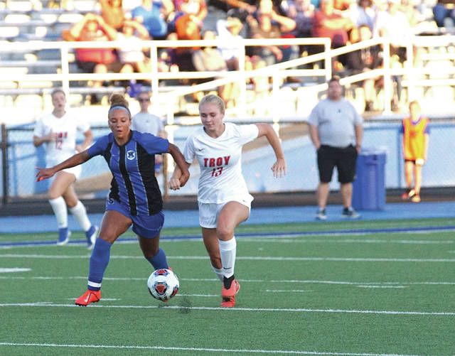 Xenia's Hazel Dye and Troy's Maddie Brewer race to gain control of the ball, Sept. 5 in a girls varsity soccer match at Doug Adams Stadium in Xenia.