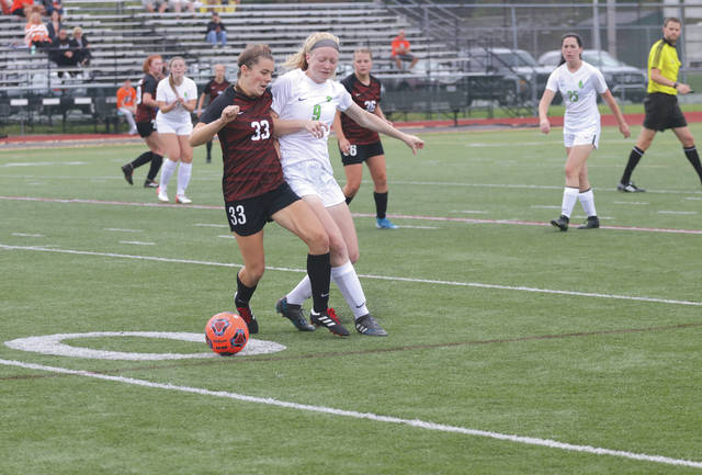 Xenia High School graduate Taylor Huffman (9), shown here in a recent 1-0 loss to Anderson (Ind.), led Wilmington College to the team's first win of the season on Sept. 11 at Cincinnati Christian. Huffman, a freshman, scored three goals and assisted on three others in the Fightin' Quakers' 6-2 win.