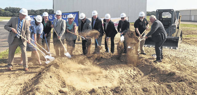 Scott Halasz | Greene County News County elected officials and other dignitaries break ground on the new Greene County Career Center's new hangar at the Lewis A. Jackson Regional Airport.