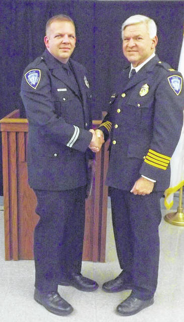 Photo courtesy City of Xenia Det. Matthew Miller (left) received the Xenia Police Division's top honor during the 28th annual Police Awards ceremony. He is pictured with Chief Randy Person.