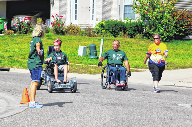 Submitted photos Families participate in Owen's Place Charity Race in Beavercreek in 2018.