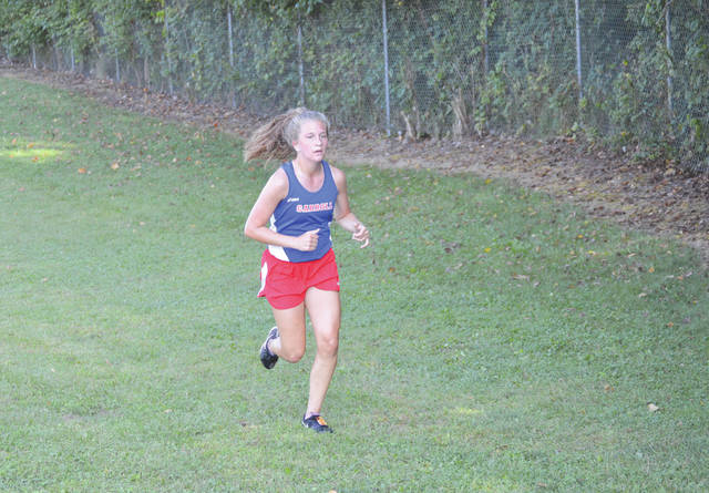 Carroll sophomore Sarah Ochs won the girls cross country race in a time of 22 minutes, 29.2 seconds, Sept. 10 at the annual Iris and Richard Black high school cross country meet at Bellbrook High.