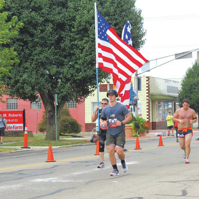Submitted photos Local citizen William David Dice took and shared photos of Air Force Marathon runners participating in the event Sept. 21. The photos were taken from the Fairborn Flyzone which welcomes marathon spectators to watch the action from downtown Fairborn.