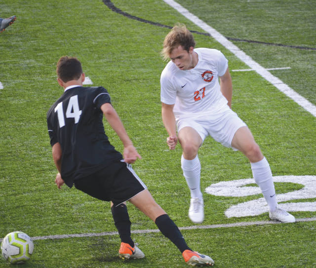 An unidentified Beavercreek defender guards against an Anderson player, during Saturday's boys varsity high school game at Beavercreek's Frank Zink Field.