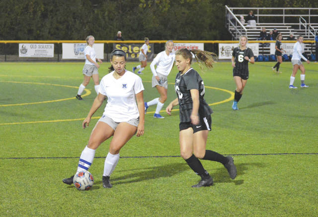 Xenia senior forward Alexis Claybaugh (left) comes under pressure by Centerville junior defender Megan Longer, in the first half of Thursday's Division I girls soccer sectional tournament game at Legacy Field in Centerville.