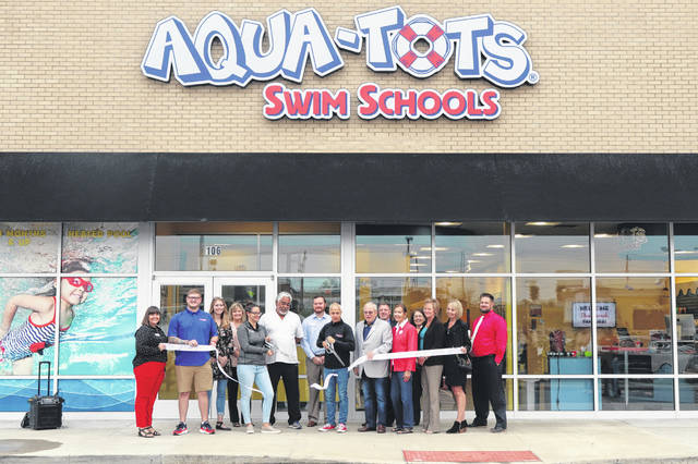 Photos courtesy Beavercreek Chamber Elected officials, Beavercreek Chamber of Commerce President Amanda Byers and Aqua-Tots Swim Schools owner Paul Sinopoli cut the ribbon to re-open the swim school Oct. 7. The business at 2451 Lakeview Drive sustained substantial damage from the Memorial Day tornadoes.