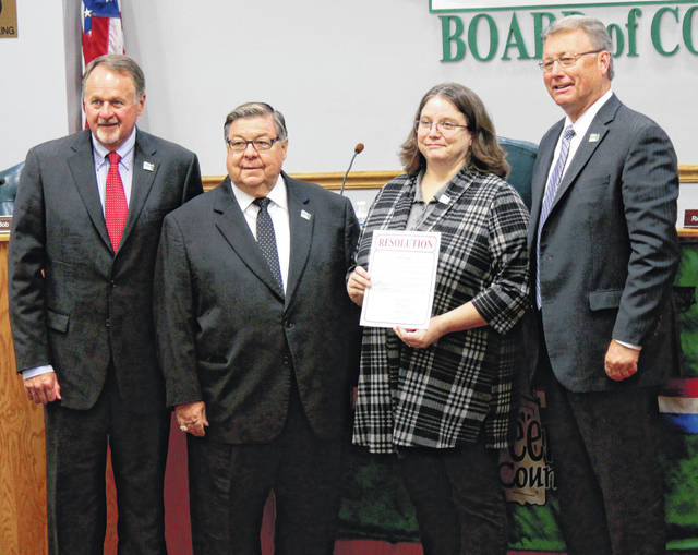 Anna Bolton | Greene County News Greene County Commissioners Dick Gould, Bob Glaser and Tom Koogler present a resolution to Greene County Archivist Robin Heise Sept. 26 proclaiming October as Archives Month.