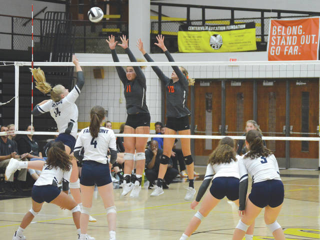Fairmont's Iris Riegel (14) tries to hit over the block of Beavercreek junior outside hitter Korina Swiderski (11) and senior middle hitter Grace Phillips (10), during a Division I sectional semifinal tournament match, Oct. 16 at Centerville High School.