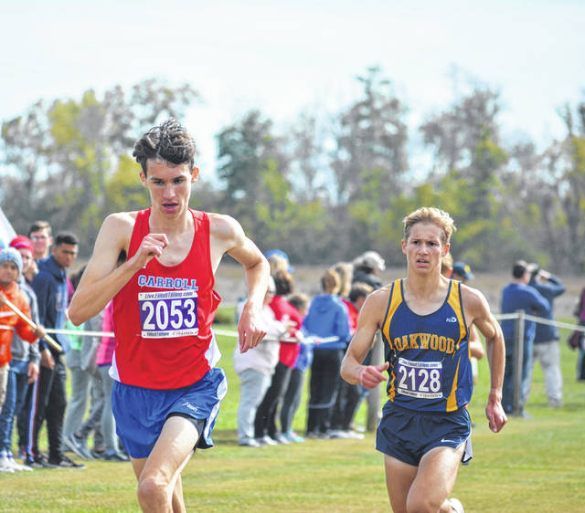 Carroll's Grant Arnold pulls ahead of Kyle Lathander to take<sup> </sup>second place in boys' Division II race.