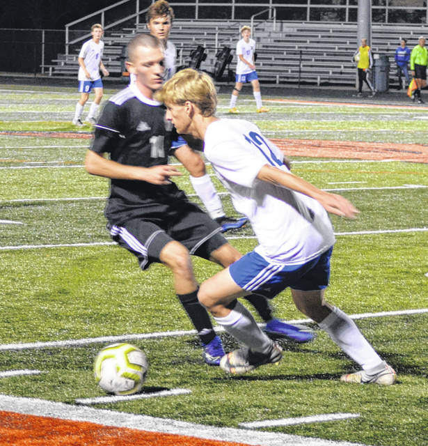 Beavercreek's Colin Campbell and Xenia's Elliot Stratton battle for possession.