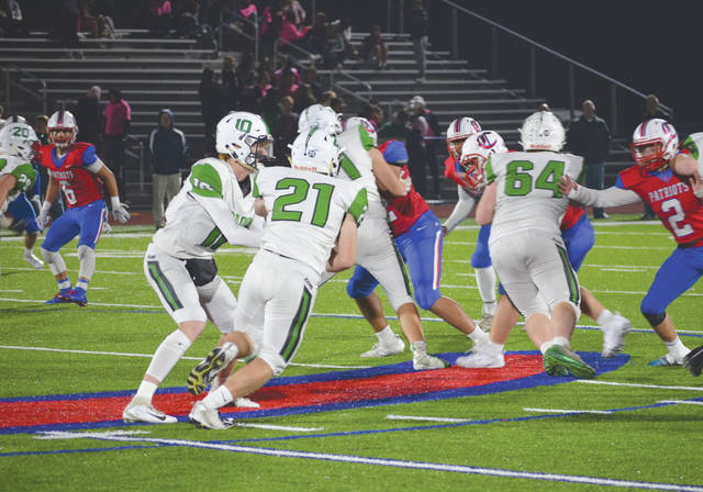 Rams running back Dallas Rawlings (21) takes a handoff from Badin quarterback Zach Switzer (10), in Friday's 45-14 win over host Carroll at Spoerl-Bartlett Field in Riverside.