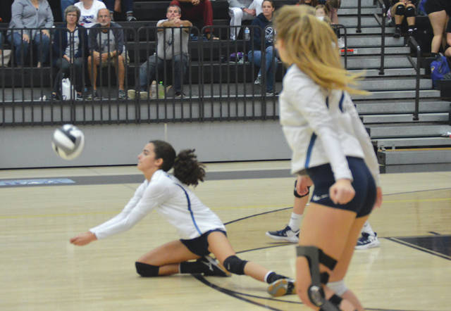 Fairborn's Hani Sampson digs out a shot during Monday night's Division I sectional tournament first round game in Centerville. The 13th seeded Skyhawks lost in four sets t0 No. 10 seed Fairmont.