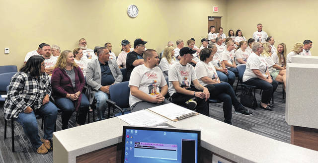 Scott Halasz | Greene County News The Xenia City Council Chamber was packed with supporters of the Alan Besco Car & Truck Superstore and Annie the Eagle, which is no longer allowed to be flown according to the land development code and the board of zoning appeals.