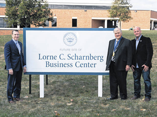 Submitted photo On the site of the future Lorne C. Scharnberg Business Center, Dr. Thomas White, president of Cedarville University, left, stands with Lorne C. Scharnberg and Mark Scharnberg.