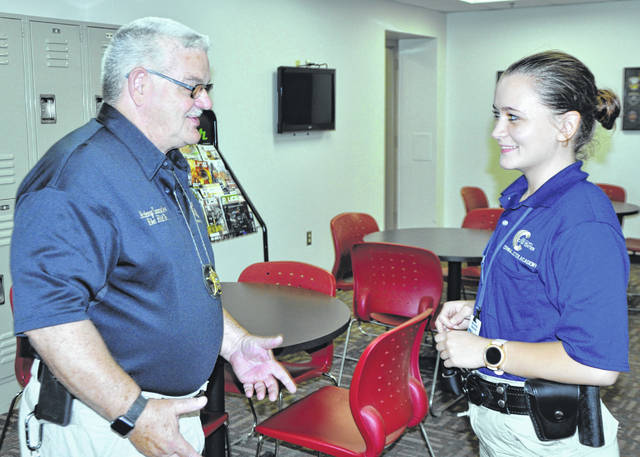 Photo courtesy GCCC Commander Mike Hild Sr. speaks with cadet, Miranda Marshall.