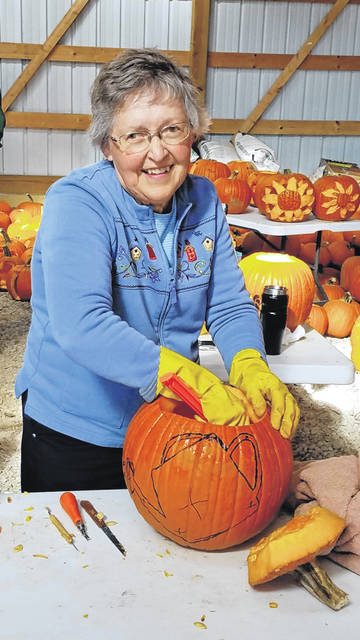 Photo courtesy GCP&T Greene County Parks & Trails volunteer Diane Bish helps gut pumpkins Oct. 23 at Hobson Freedom Park, which will come alive with jack-o-lanterns Friday and Saturday during Pumpkin Glow.