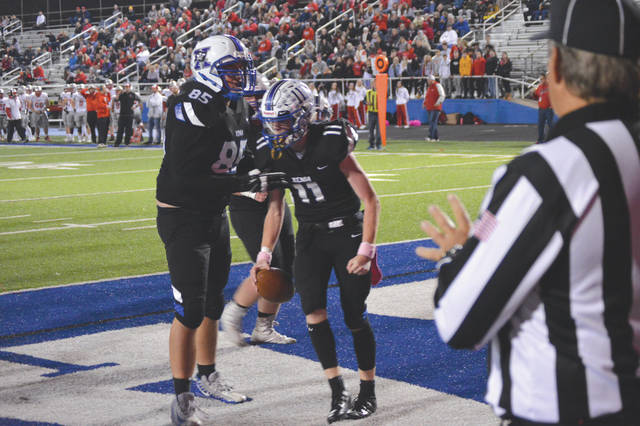 Xenia quarterback Brett Russell (11) celebrates after scoring a first quarter touchdown, Oct. 25 at Doug Adams Stadium.
