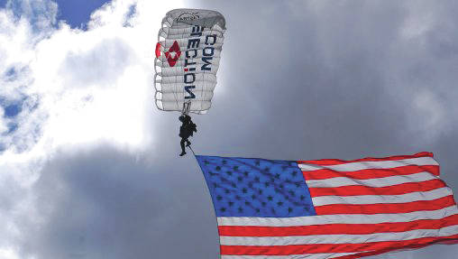 Submitted photo Team Fastrax Professional Skydiving Team will parachute in the American flag and the game ball before the USA Patriots Amputee Softball Team game at 10:30 a.m. Nischwitz Stadium during Festival of Flight.