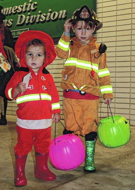 A little rain didn't keep costumed families from visiting Ledbetter Road to trunk-or-treat Oct. 30. The annual Halloween event, put on by Greene County Children Services, means goodies for children and community services' resources for parents. Various local agencies and organizations participated this year.