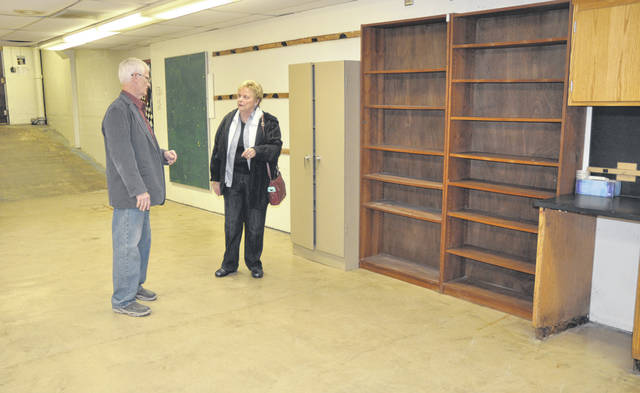 Gregg Cross and Elaine Anderson reminisce about old times in one of the areas underneath the seats at Benner Field House.