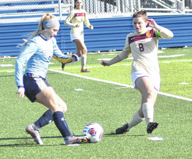 Scott Halasz | Greene County News Cedarville University's Hannah Atkinson (left) prepares to make a move to get around Walsh's Hannah Bowman during the first half of a Great Midwest Athletic Conference semifinal Thursday. Walsh won 2-1 in overtime.