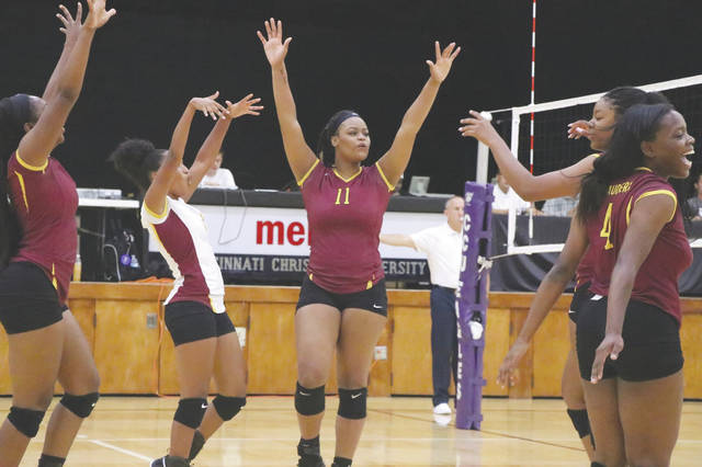 Central State University junior outside hitter Deja Clark (11) celebrates a point with teammates during a women's college volleyball match against Cincinnati Christian University. Clark was named the Southern Intercollegiate Athletic Conference's Player of the Year for 2019.
