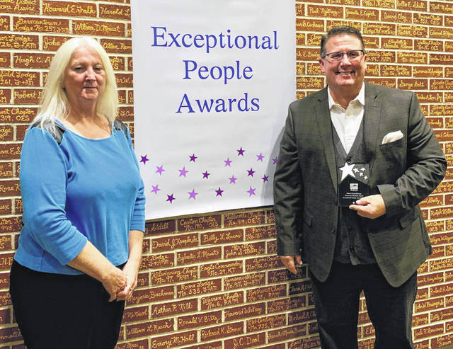 Photos courtesy MHRB Pastor Greg Delaney, outreach coordinator at Woodhaven Recovery, receives a Person of the Year Award. Lynne Carroll, program director at Sober Lotus Recovery Homes, nominated him.