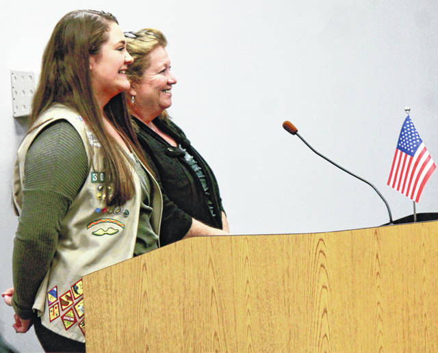 Anna Bolton | Greene County News Meredith Dillon from Beavercreek Girl Scout Troop 30937 and Julie Holmes-Taylor, Greene County Animal Care & Control Director, speak at a Board of Commissioners meeting Nov. 14.
