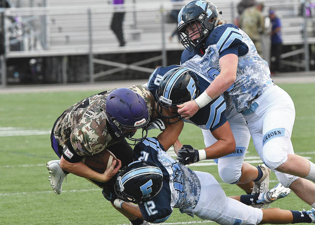 Fairborn's Hunter Warner (far right) was named the Division II Southwest District Defensive Player of the Year for 2019.