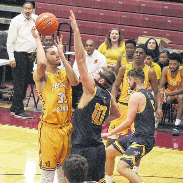 Photo courtesy Central State University Michael Reeves goes up for two of his 12 points as Cedarville's Kollin Van Horn defends.