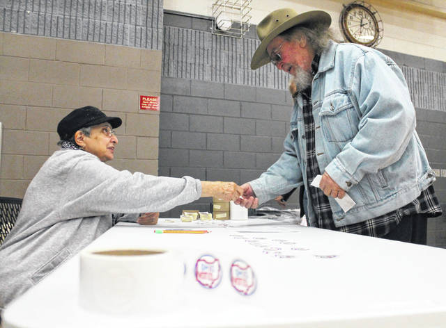 "A Xenia voter receives the new ""I voted"" stickers Nov. 5 at the Xenia Community Center polling place."
