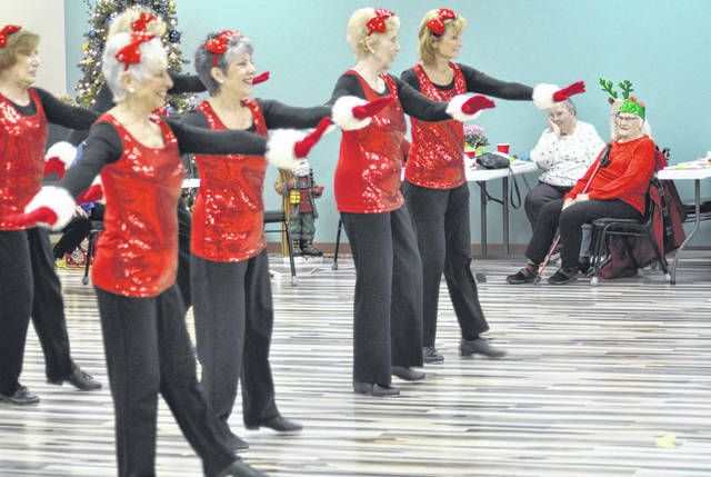 Photos by Scott Halasz   Greene County News The family of the late Dr. Clement Austria hosted the 43rd Annual Christmas Party Dec. 11 at the Xenia Adult Recreation and Services Center. It's the first time the senior center was actually able to host it, thanks to its new location in the REACH Center. The Senior Sensations entertained the 252 in attendance with several dance numbers.