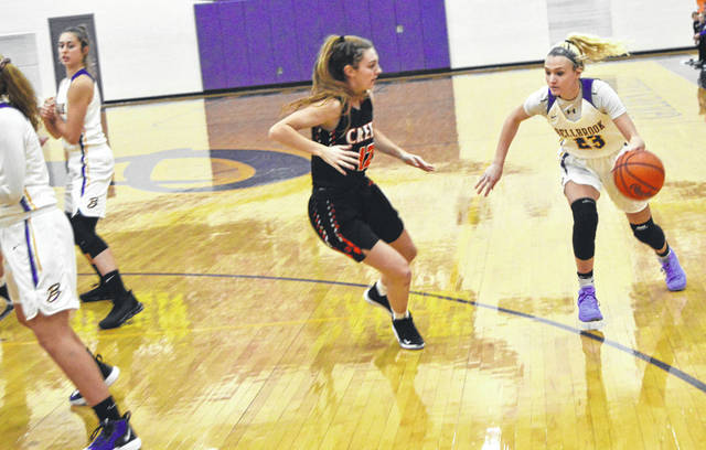 Photos by John Bombatch | Greene County News Bellbrook junior Bailey Zerby looks to drive during the season opener against Beavercreek. Zerby has improved her game this season, taking better shots and not settling for three pointers.