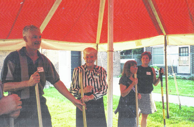 Photo courtesy FVPC Former Greene County Commissioner Kathryn Hagler breaks ground at the June 2000 ceremony for the new domestic violence shelter named after her, which opened in May 2001 at 380 Bellbrook Avenue, Xenia. Alongside her are Pete Hagler (left) and Cindy Minton (right).