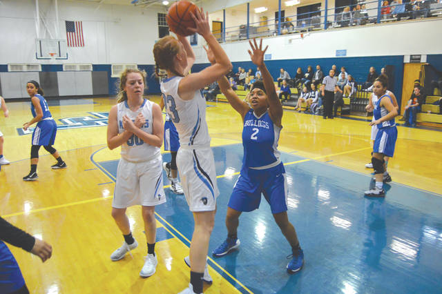 Legacy Christian's Emma Hess (23) puts up a shot over Annlyn Foster (2) of Yellow Springs, during the first half of a girls high school basketball game, Dec. 9 in Xenia.