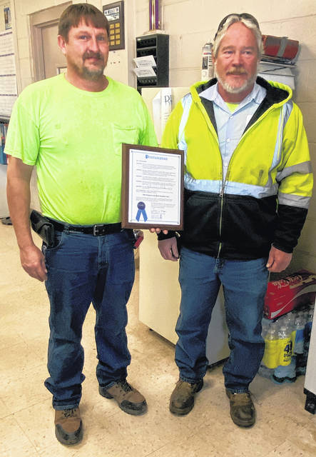 Bill Rogers (left) and Bob Hughes hold the proclamation honoring them for helping save a man's life earlier this week.