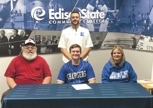 Beavercreek High School right-handed pitcher/first baseman Kevin Bellamy (center) joined three others in signing to play college baseball at Edison State Community College, Dec. 12 in Piqua. Bellamy was one of four players to commit to the school beginning with the Spring 2021 season. Edison State is a Division II National Junior College Athletic Association team that competes in the Ohio Community College Athletic Conference.