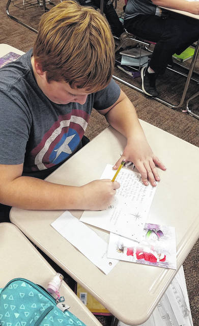 Cedarville sixth grader Mack Foerch writes a letter to a service member.