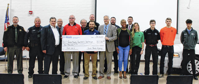 Anna Bolton | Greene County News Local law enforcement, Allstate Agent Scott Pauley, school officials and Greene County Career Center students gather for an Allstate Seat Belt Challenge check presentation Dec. 6.