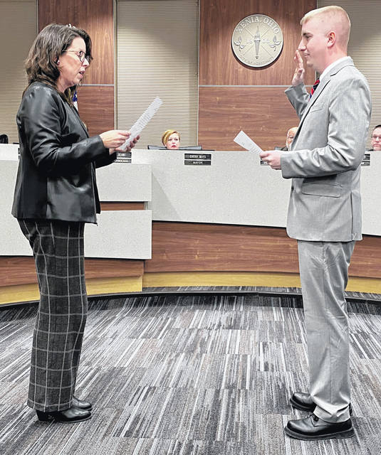 Photos by Scott Halasz | Greene County News Xenia City Council welcomed two new members last night in addition to a former member who was once again elected. A fourth was reelected to a second-consecutive term. Law Director Donnette Fisher administers the oath of office to newcomer Cody Brannum.