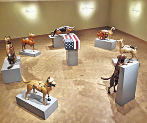 Photo courtesy Cedarville University Retired Cedarville University professor of studio art James Mellick has his wooden dog sculptures on display through Jan. 31, at the National Museum of the United States Air Force.