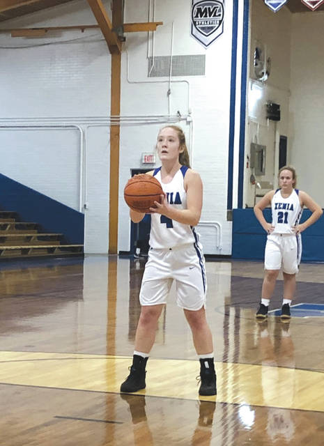 Sophomore guard Haley McManus (4) sets up to shoot a free throw, as fellow soph Brynna Mardis looks on. McManus led Xenia with seven points in Saturday's loss to Butler at the Benner Fieldhouse.